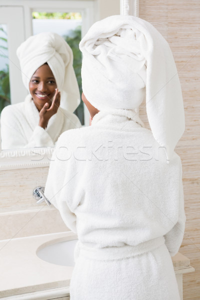 Young woman applying moisturizer Stock photo © wavebreak_media