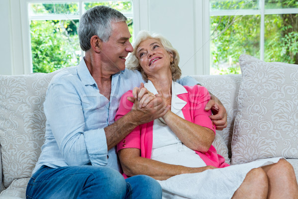 Loving senior couple looking at each other in living room Stock photo © wavebreak_media