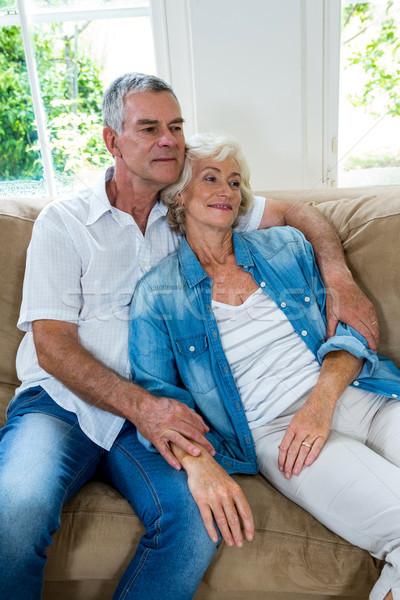 Altos mujer relajante marido sesión habitación Foto stock © wavebreak_media