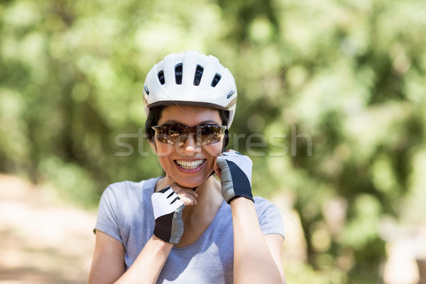 Portrait of a woman bike rider smiling Stock photo © wavebreak_media
