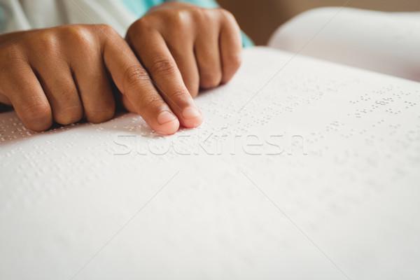 Girl using braille to read Stock photo © wavebreak_media