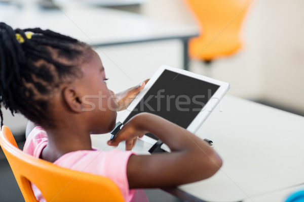 Side view of pupil using tablet pc in classroom Stock photo © wavebreak_media