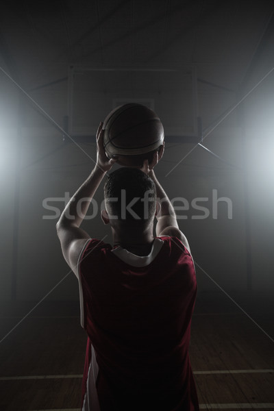 Portrait of basketball player front the back preparing to score Stock photo © wavebreak_media