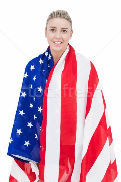 Female athlete with american flag on her shoulders Stock photo © wavebreak_media