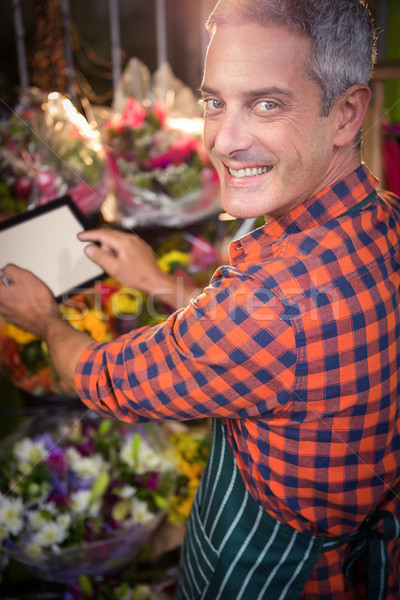 Male florist taking photo of flower bouquet Stock photo © wavebreak_media