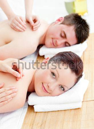 Relaxed woman being back massaged by masseuse Stock photo © wavebreak_media