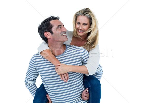 Mosolyog férfi hordoz nő háton fehér Stock fotó © wavebreak_media