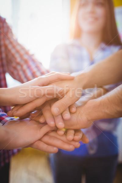 Creative business people stacking hands  Stock photo © wavebreak_media
