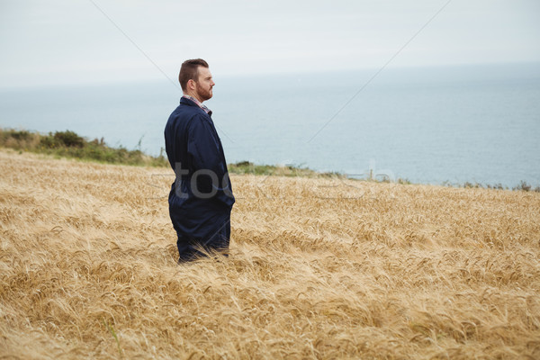 Farmer standing in the field Stock photo © wavebreak_media
