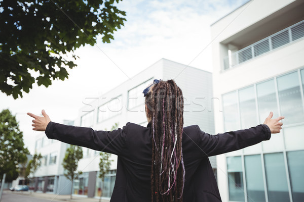 Businesswoman standing with arms outstretched Stock photo © wavebreak_media