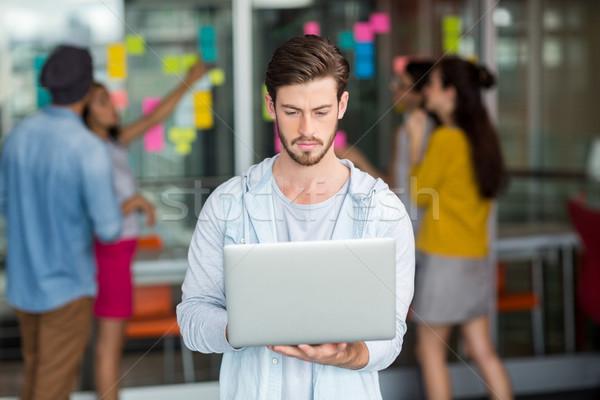 Attentive male executive using laptop Stock photo © wavebreak_media