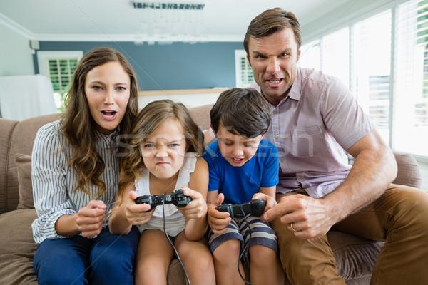 Photo stock: Famille · heureuse · jouer · jeux · vidéo · ensemble · salon · maison