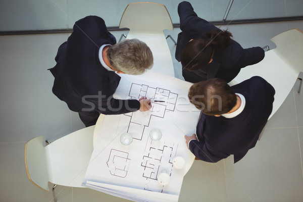 High angle view of businesspeople discussing over blueprint Stock photo © wavebreak_media