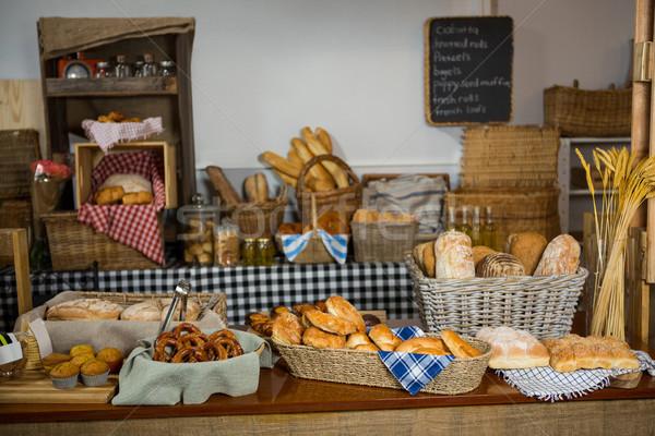 Pão bolinhos contrariar padaria compras Foto stock © wavebreak_media