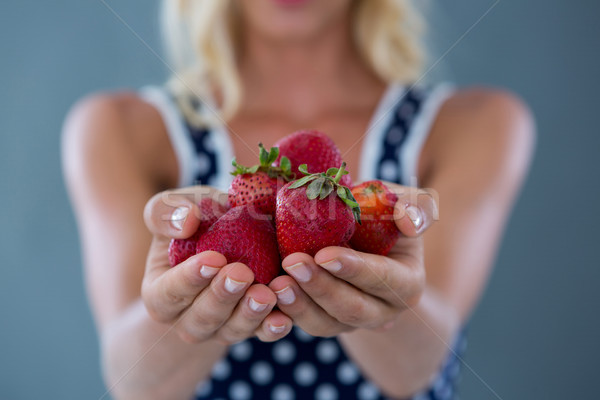 Mid-section of woman holding strawberries Stock photo © wavebreak_media