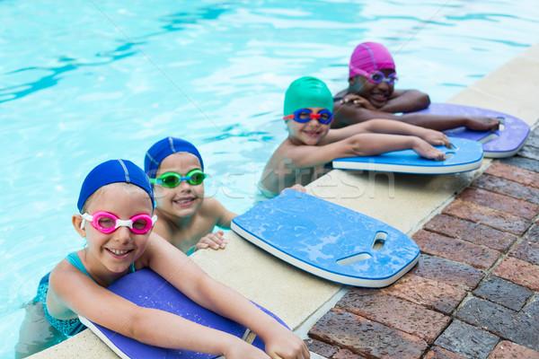 Pequeño agua nina gimnasio piscina nino Foto stock © wavebreak_media