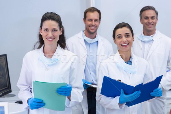 Mosolyog fogorvosok áll fogászati klinika nő Stock fotó © wavebreak_media