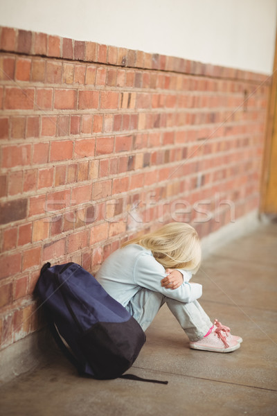 Sad pupil sitting alone on ground Stock photo © wavebreak_media
