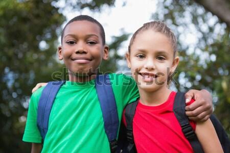Cute pupils smiling at camera outside Stock photo © wavebreak_media