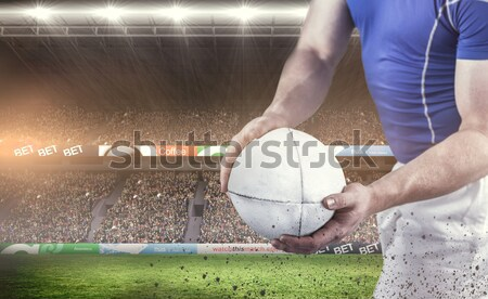 Composite image of midsection of rugby player in black jersey ho Stock photo © wavebreak_media