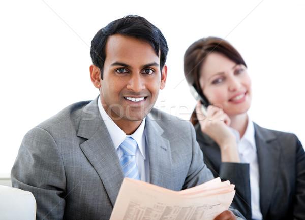 Uśmiechnięty biznesmen czytania gazety poczekalnia posiedzenia Zdjęcia stock © wavebreak_media