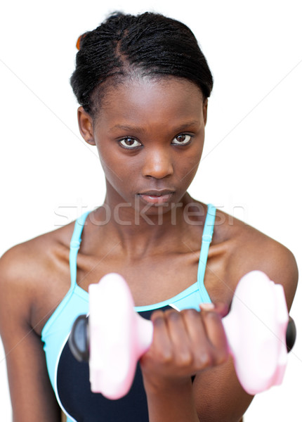 Attractive woman working out with dumbbell  Stock photo © wavebreak_media