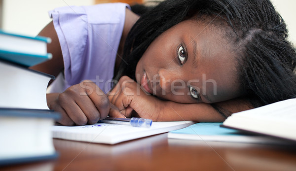 Exhausted Afro-American woman resting while studying Stock photo © wavebreak_media