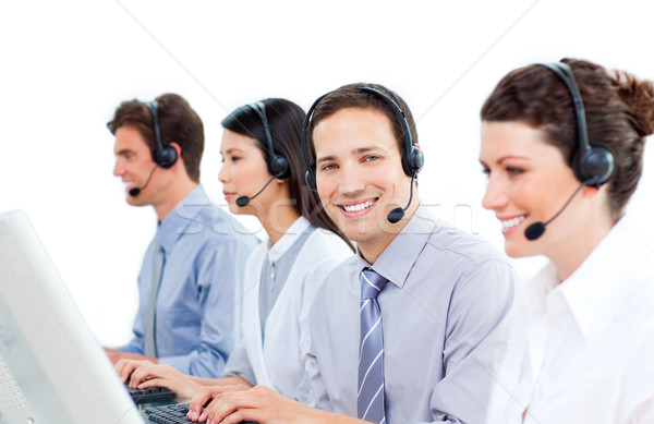 Confident customer service agents working in a call center Stock photo © wavebreak_media