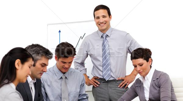 Bájos tolakodó üzletember bemutató mosoly férfi Stock fotó © wavebreak_media