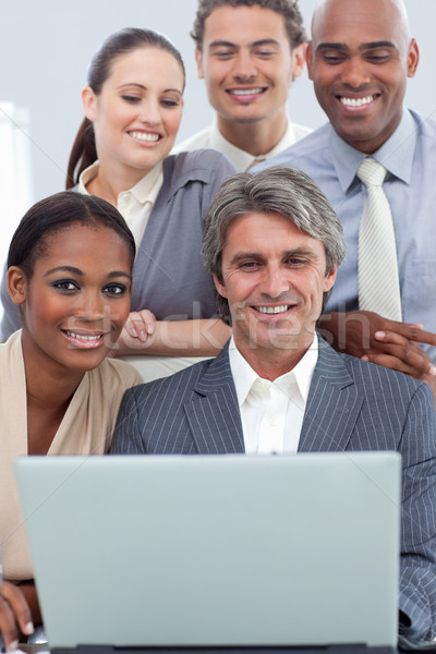 A business group showing ethnic diversity working at a laptop  Stock photo © wavebreak_media