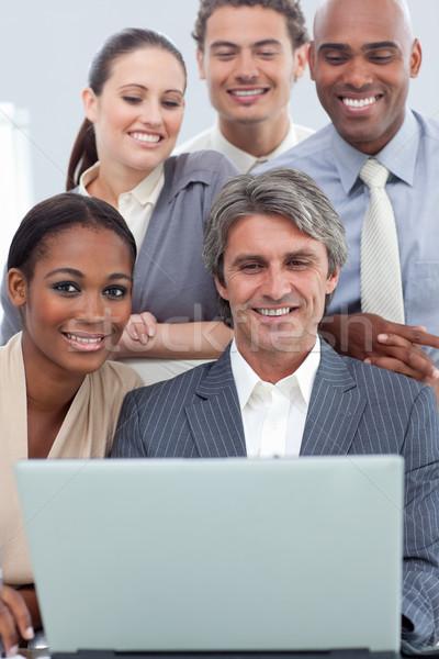 La diversidad étnica de trabajo portátil oficina Foto stock © wavebreak_media