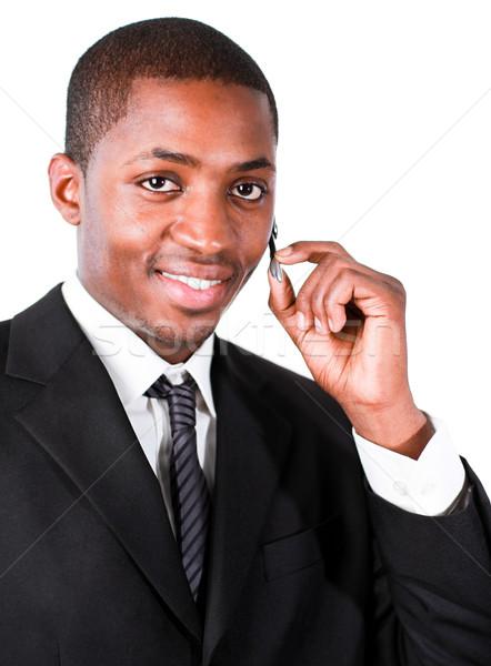 Businessman wearing an earpiece in front of the camera Stock photo © wavebreak_media