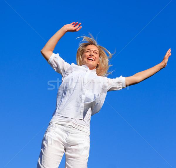 Cheerful woman jumping in the air Stock photo © wavebreak_media