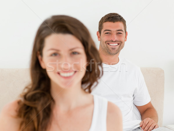 Happy man lying on his bed with his girlfriend in the foreground Stock photo © wavebreak_media