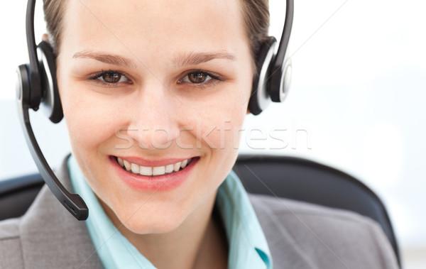 Portrait of a pretty operator with earpiece in her office Stock photo © wavebreak_media