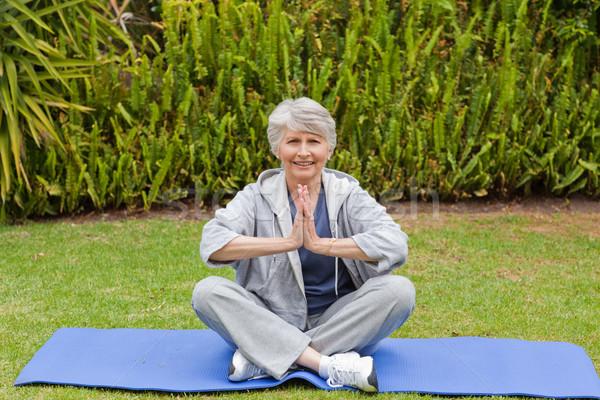 Retired woman practicing yoga in the garden Stock photo © wavebreak_media