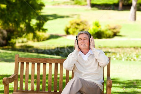 Retired man listening to some music Stock photo © wavebreak_media