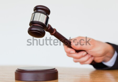 Feminine hand knocking a gavel against a white background Stock photo © wavebreak_media