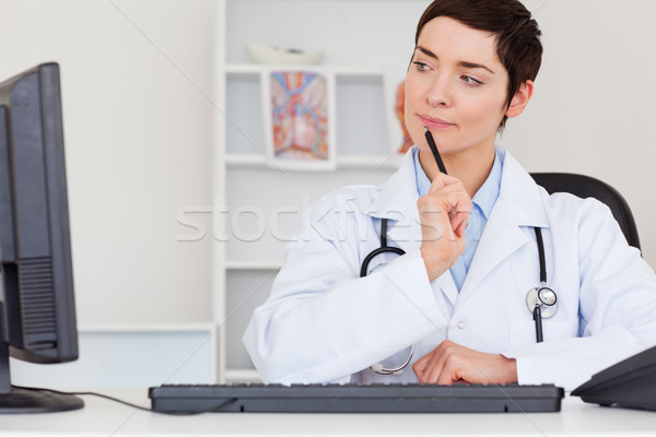 Thoughful female doctor in her office Stock photo © wavebreak_media