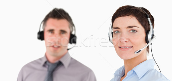 Close up of managers using headsets against a white background Stock photo © wavebreak_media