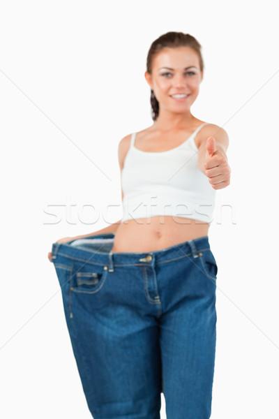 портрет женщину большой джинсов большой палец руки Сток-фото © wavebreak_media