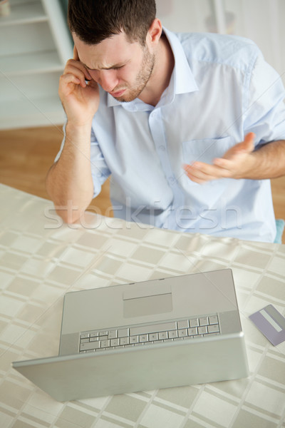 Jovem empresário argumento telefone negócio computador Foto stock © wavebreak_media