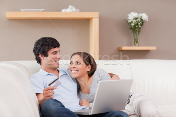 Cheerful young couple booking holiday online Stock photo © wavebreak_media