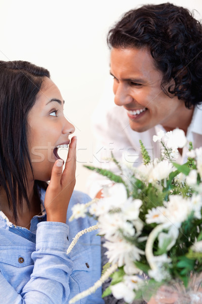 Young woman is surprised by the bouquet she got from her boyfriend Stock photo © wavebreak_media