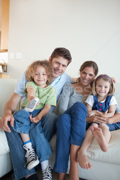 Portrait of a happy family watching TV together in their living room Stock photo © wavebreak_media
