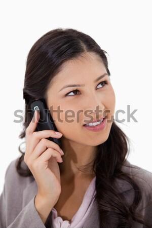 Femme écouter visiteur téléphone blanche téléphone Photo stock © wavebreak_media