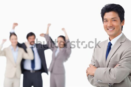 Successful salesman getting celebrated by colleagues against a white background Stock photo © wavebreak_media