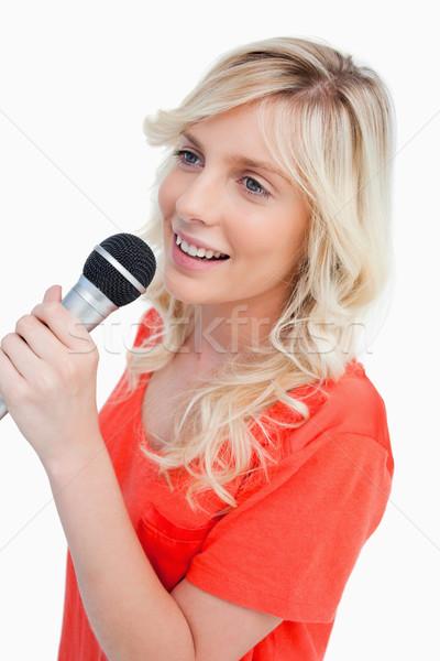 улыбающаяся женщина пения микрофона белый весело энергии Сток-фото © wavebreak_media