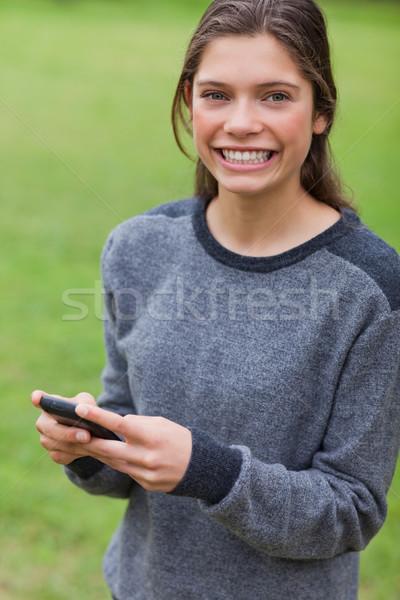 молодые улыбаясь взрослый глядя прямой камеры Сток-фото © wavebreak_media