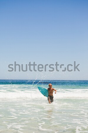 Homem corrida água prancha de surfe Foto stock © wavebreak_media